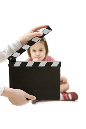 little girl with a movie clapper isolated on white background  photo