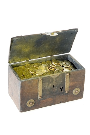 ancient chest full of golden coins isolated on white background  photo