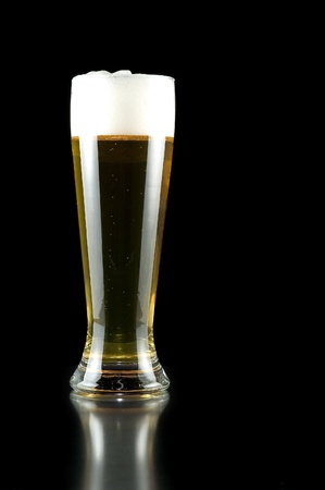 glass of beer on a black background  photo