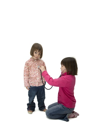 two little girls playing with a stethoscope Stock Photo - 9728357
