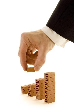 zakenman buiding een grafiek met bakstenen Stockfoto