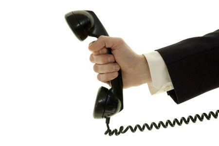 answering phone: hombre de negocios con tel�fono aislado en blanco