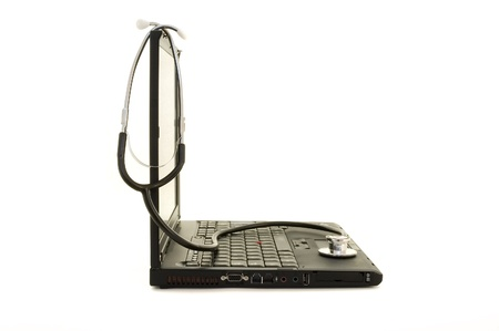 stethoscope on a laptop isolated on white  photo