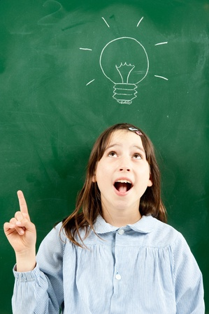 girl with blackboard and lightbulb over her head  photo