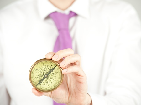 Businessman holding an old compass Stock Photo - 9869109