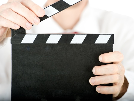 businessman with a clapperboard isolated on white background Stock Photo