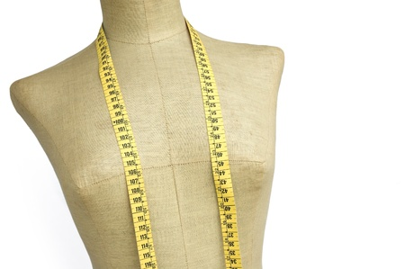 made to measure: taylor mannequin with tape measure isolated on white