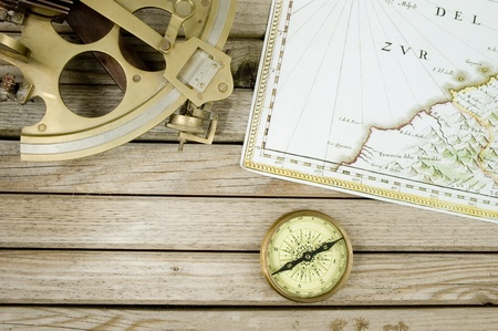 old map (1640 copyright expired) sextant and compass on wood background photo