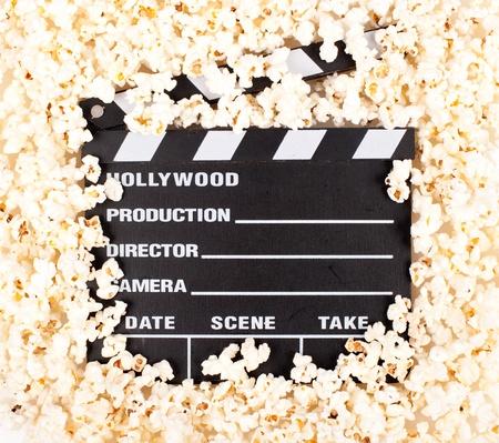 movie clapper board with popcorn photo
