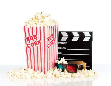 popcorn box with clapper board and 3d movie glasses on white background photo