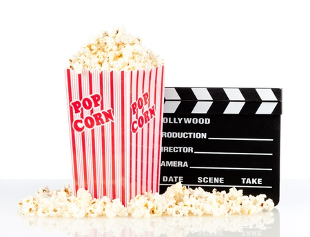 popcorn box with clapper board on white background Stock Photo