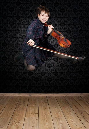 girl with violin jumping photo