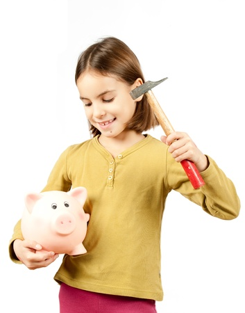 little girl breaking a piggy bank photo
