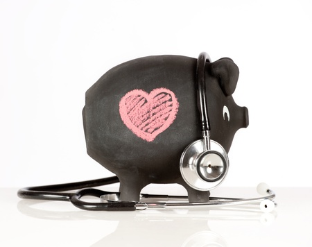 piggy bank with stethoscope photo