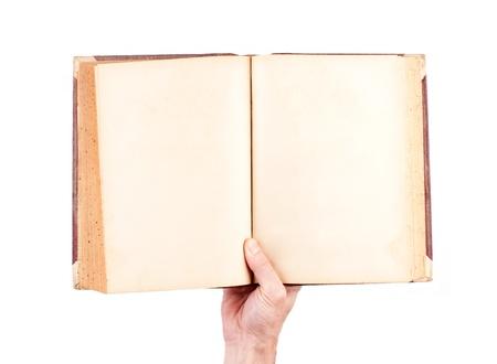 hand die blanco oude boek geà ¯ soleerd op witte achtergrond