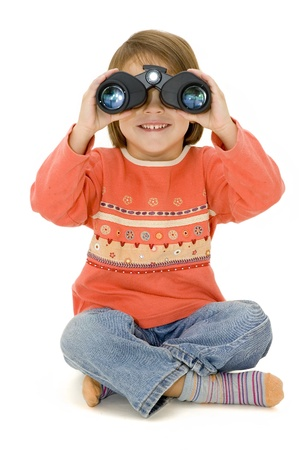 little girl watching with binoculars Stock Photo