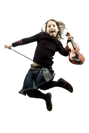 young girl with violin jumping isolated on white photo