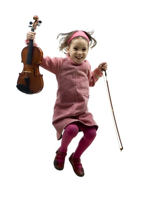 little girl with violin jumping isolated on white Stockfoto