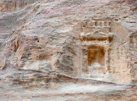 nabatean: nabatean door work in the rock in Petra, Jordan Stock Photo
