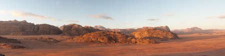 panoramic view of wadi rum desert at sunrise photo