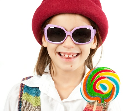 little girl with lollipop on white background Stock Photo - 12173836
