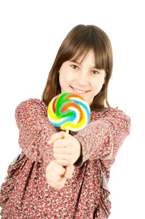 young girl with lollipop isolated on white background photo