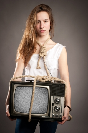 young girl with rope holding retro television photo