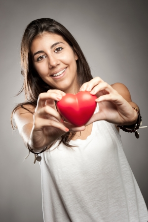 woman holding a red heart Stock Photo - 17573454