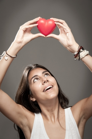 woman holding a red heart Stock Photo - 17573456