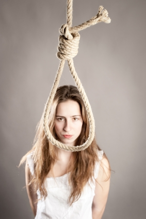 woman in front of a rope committing suicide photo