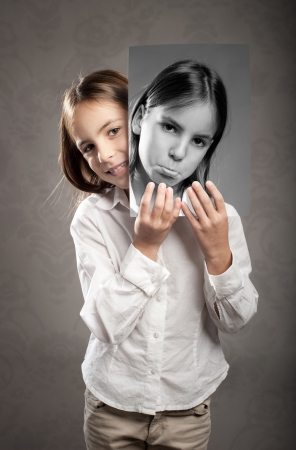 portrait of little girl with two faces photo