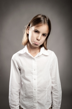 little girl with sad expression on face Stock Photo - 17565431