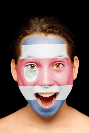 costa rica flag: portrait of girl with Costa Rican flag painted on her face Stock Photo