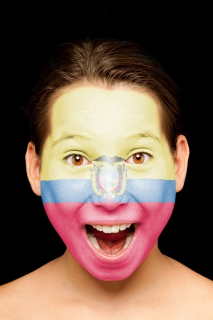 ecuador: portrait of girl with ecuadoran flag painted on her face Stock Photo