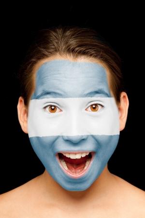 bandera de el salvador: Retrato de niña con bandera salvadoreña pintada en su cara
