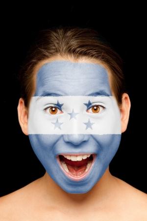 bandera honduras: Retrato de niña con Honduras bandera pintada en la cara Foto de archivo