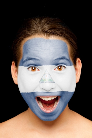 nicaraguan: portrait of girl with nicaraguan flag painted on her face