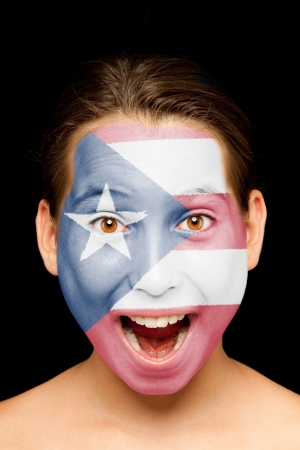 puerto rican flag: portrait of girl with puerto rican flag painted on her face Stock Photo