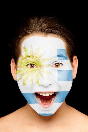 portrait of girl with uruguayan  flag painted on her face photo