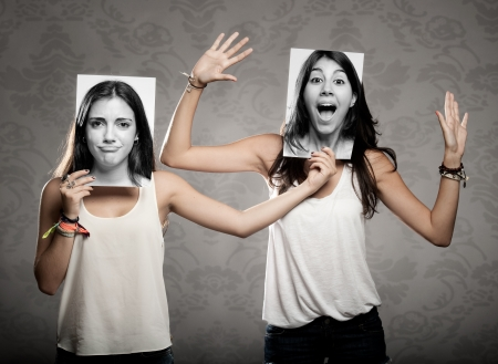 portrait of two girls holding a photography in front of face Stock Photo