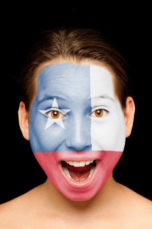 portrait of girl with chilean  flag painted on her face photo