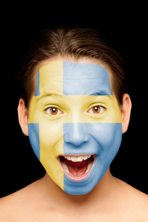 portrait of girl with swedish  flag painted on her face photo