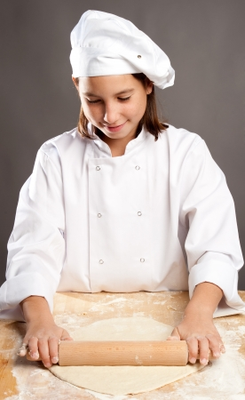 young chef working the dough photo