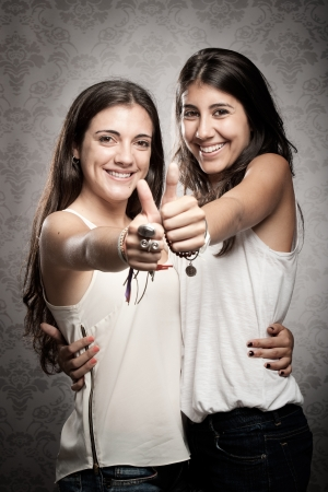 two happy girls with thumbs up Stock Photo - 17601295