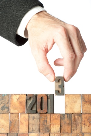 businessman building year 2013 in letterpress on white background photo