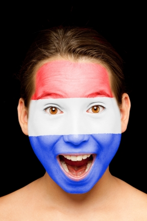 portrait of girl with Netherlands flag painted on her face Stock Photo - 17601327