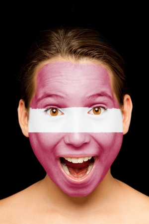 portrait of girl with latvian flag painted on her face Stock Photo - 17601329