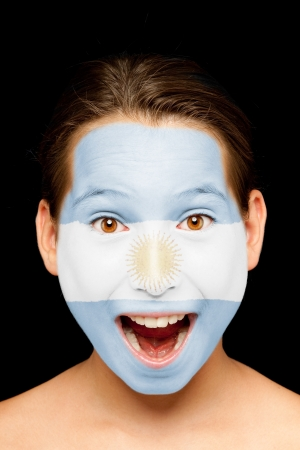 argentinian flag: portrait of girl with argentinian flag painted on her face Stock Photo