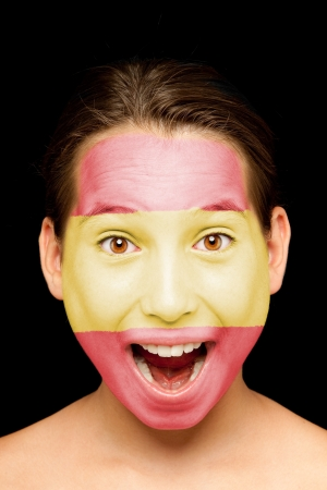 flag spain: portrait of girl with spanish flag painted on her face