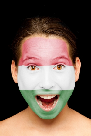portrait of girl with hungarian flag painted on her face Stock Photo - 17601372